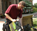 Electrician Brian DeKonnick unpacks new LED up-lights.