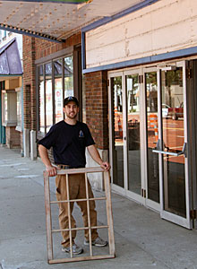 Robin Adair, '00, with a window frame outside Albion's Bohm Theatre, July 2012