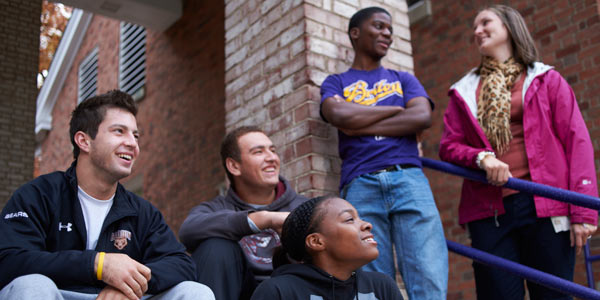 A group of Albion College students on the steps of Baldwin Hall, 2012.