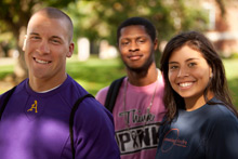 Three Albion College students photographed in 2011.