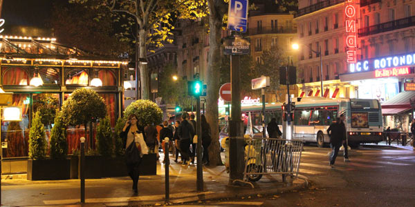A Paris district, or arrondissement, at night.
