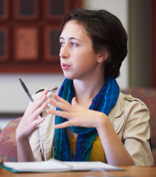 An Albion College student asks a question in class.