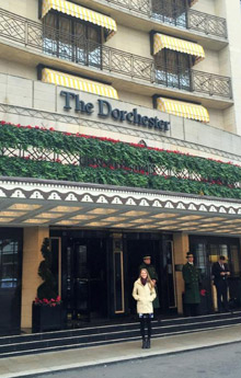 Kristen Beyer, '16 poses in front of the Dorchester.