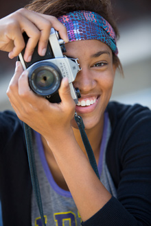 Albion College student with camera, fall 2013