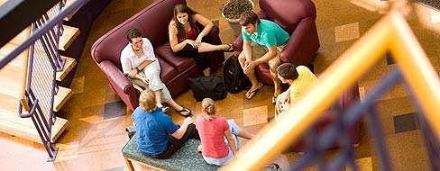 Students collaborating in the science complex atrium