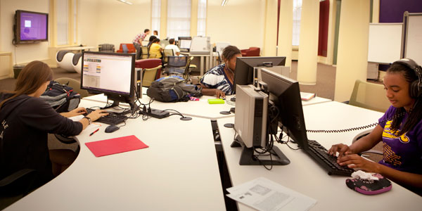 Students at computer stations in Stockwell Library's Cutler Commons.
