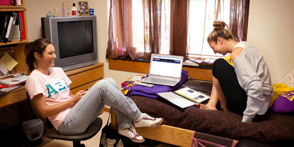 Two students in an Albion College residence hall room.