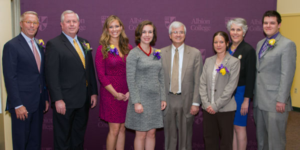 Albion College 2015 Distinguished Alumni and Young Alumni Award recipients stand with President Mauri Ditzler. From left: Bill Payne, '75; Rick Going, '77; Danielle Wysocki, '10; Katie Kirsch, '12; Ditzler; Cindy Cardwell Fast, '08; Katherine Look, '75; and Jon Reynolds, '09.