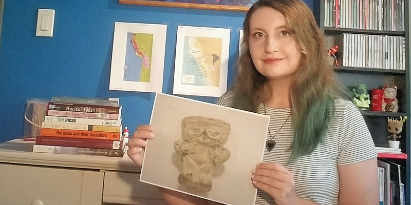Rebecca Wagener, '21, with a photo of one of the nine artifacts she researched for her summer FURSCA project. Wagener is a senior majoring in anthropology and art history with minors in geology and history. Wagener is the child of Claudia and Tony Wagener of Shelby Township and a graduate of Eisenhower High School.
