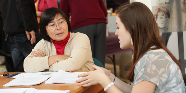 A student consults with Midori Yoshii, associate professor of international studies, during Declare a Major Night 2013.