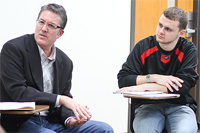 Michael Brown, '87, left, is mentoring a management class during the spring 2012 semester.