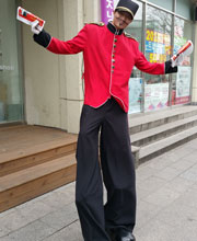 Man on stilts handing out pamphlets for LG electronics store in Seoul