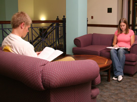 Students study in a Robinson Hall common area.