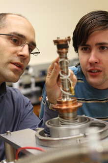 Albion College physics professor Aaron Miller works with a student.