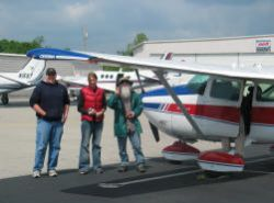 Mike, Lindsay, and Wes prepare for their Southwings flight