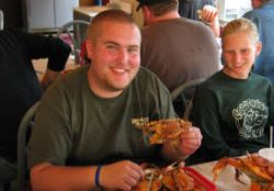 Alex enjoys boiled crab at Harris Crab House.  Owner Karen Ortel gave her perspectives on bay issues, challenging scientists for endlessly seeking grants rather than action, and environmentalists for being too cautious about introducing Pacific oysters