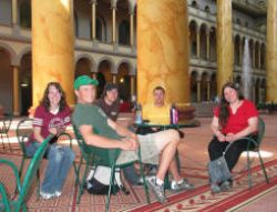 Students relax in the National Building Museum after visiting the display on green building
