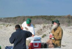 Kapil, John and Wes prepare dinner on Assateaque Island