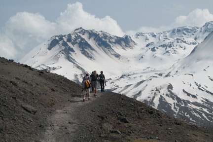 Hiking near Mount St. Helens, observing recovery from a natural disaster.