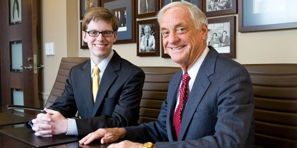 Nathaniel Love, '13, with Dennis Cawthorne, '62, of Lansing lobbying firm Kelley Cawthorne.