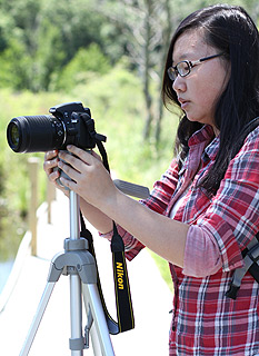 Bian Wang works on her documentary at the Whitehouse Nature Center.