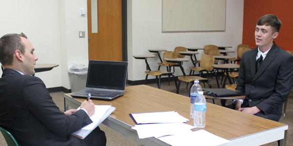 A student and a potential employer during a mock interview.