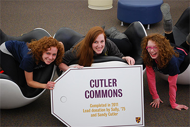 Philanthropy Week - Students with the Cutler Commons building sign