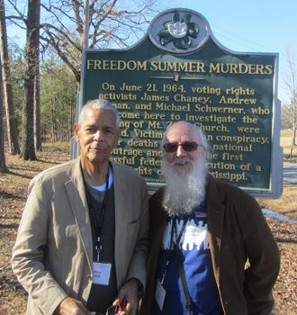 Wes Dick (right) with civil rights leader Julian Bond in front of the Freedom Summer historical marker in Mississippi.