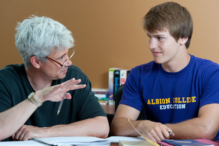 Education professor Kyle Shanton with an Albion College student.