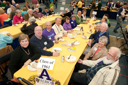 Class of 1961 members meet during the 2011 pregame picnic in the Dow Center.
