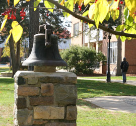The Albion College Bell sits just east of Robinson Hall.