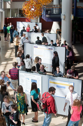 Isaac Symposium student research poster presentations in the Science Complex Atrium.