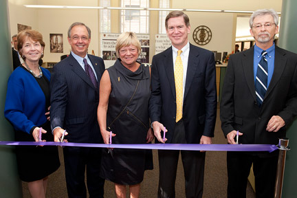 Oct. 7: Sally Stark Cutler, '75, (center) leads the ribbon cutting.