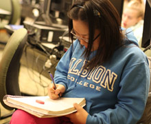 An Albion College mathematics student studying in a Department lab.