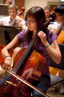 An Albion College student plays the cello.