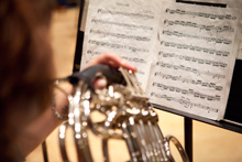An Albion College music student practices the French horn.