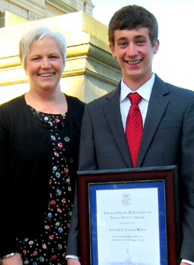 Andrew Reed receives the Frank M. Fitzgerald Public Service Award, given annually to outstanding young legislative volunteers.