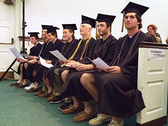 Seven seniors of the Albion men's lacrosse team received their degrees Friday, May 8, at a mini Commencement ceremony in Wesley Chapel before their NCAA Tournament game the following day.