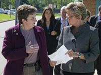 Leslee Fritz, '94, (left) confers with Governor Jennifer Granholm.