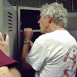 Phil Hostetler (professor of psychology, emeritus) repairs a locker to be used by workers in the document-shredding area.