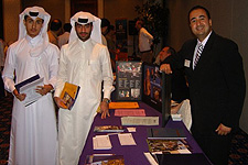 Lewis Cardenas presents admission materials to interested students in Qatar.
