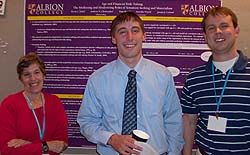 Kevin Zabel, '09, is flanked by Pam Marek, professor of psychology at Kennesaw State University and associate editor of Teaching for Psychology, and Andrew Christopher, professor of psychology at Albion College. The photograph was taken at Zabel's poster presentation during the 2009 Association for Psychological Science convention.