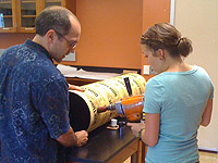 Physics professor Aaron Miller and Holly Farris drill a portion of the telescope