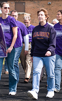President Donna Randall (right) walks alongside first-year student Helen Habicht. C. Amos photo.
