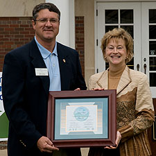 Albion College grounds supervisor Mark Frever (left) receives the certification in the Michigan Turfgrass Environmental Stewardship Program from Debra Swartz of the Michigan Department of Agriculture's Environmental Stewardship Division. C. Amos photo.