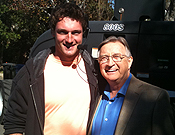 Dave Wunderlich, '12, stands with Ken Jenkins who plays the role of Chick on Cougar Town.