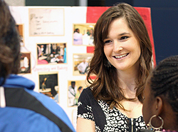 "Kelsey Lademan, '12, talked with visitors to her display at the ""Showcase of Learning"" in the Science Complex Atrium. Dave Lawrence photograph"