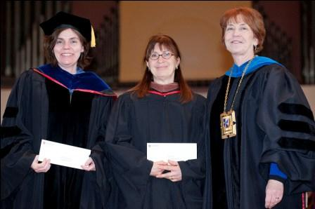 Education department chair Suellyn Henke (left) and art professor Lynne Chytilo (center), jointly named professor of the year at the annual Honors Convocation, were congratulated by President Donna Randall.