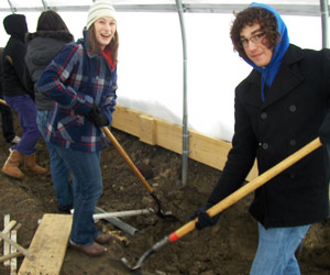Chelsea Denault works with Alex Seasock at Earthworks Urban Farm