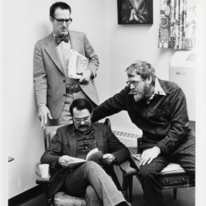 "Frick (center) with colleagues William Gillham (standing) and Johan Stohl, a group affectionately known as ""the Trinity"" by students."
